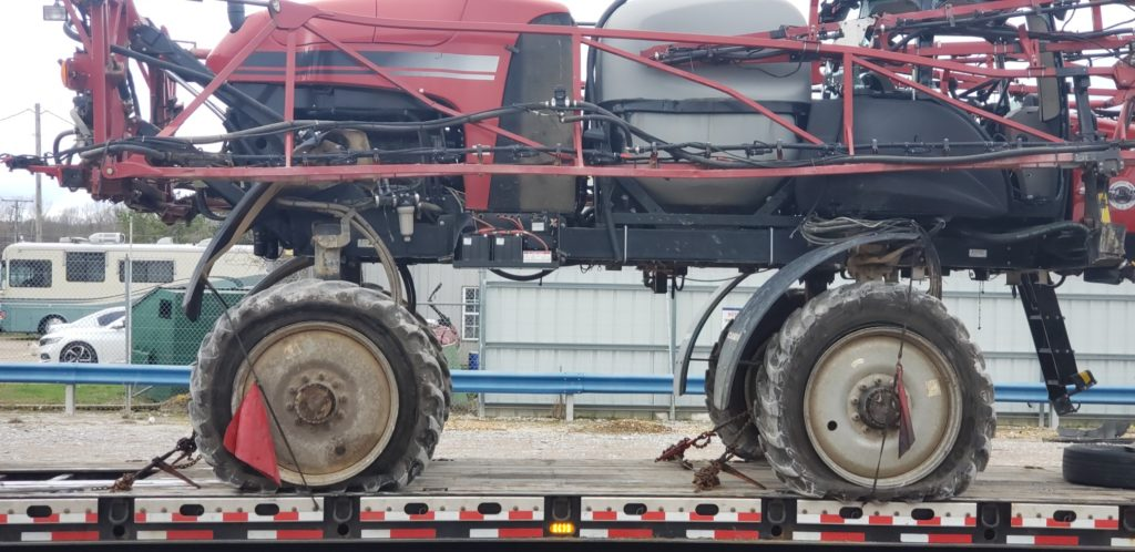 Red Sprayer on a Trailer