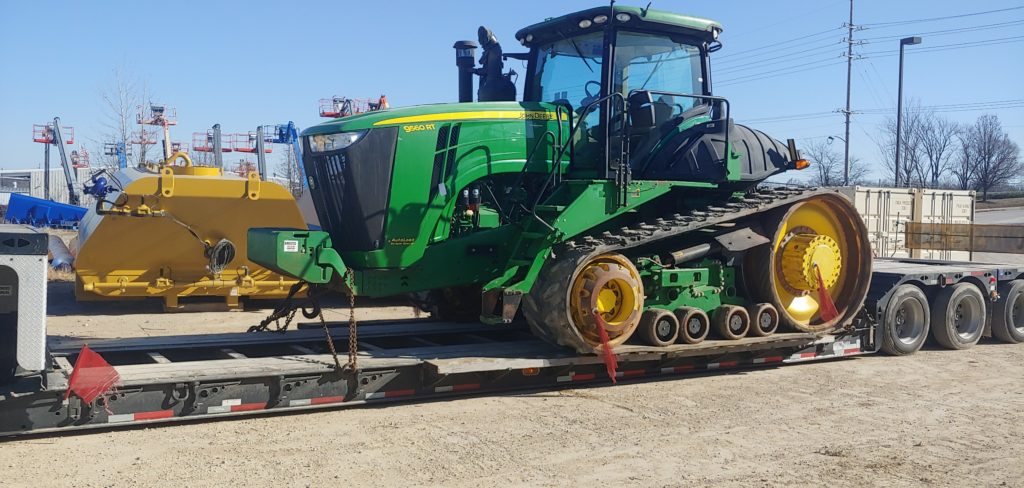 Green Tractor on a trailer