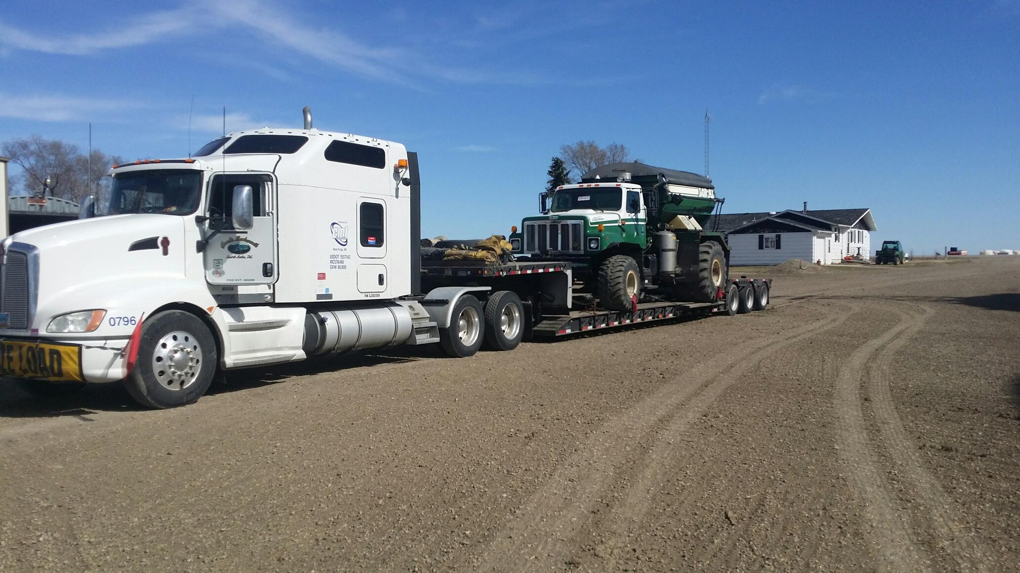 Transporting Loral 310 Floater Truck