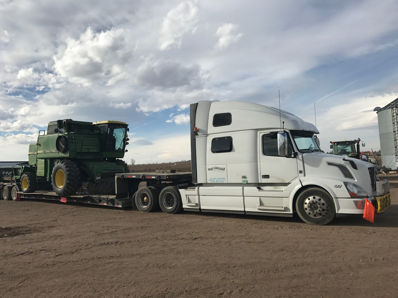john deere 7720 being transported