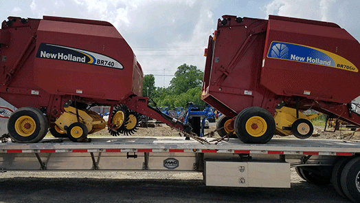 Transporting a pair of New Holland BR740A and BR70CU Balers