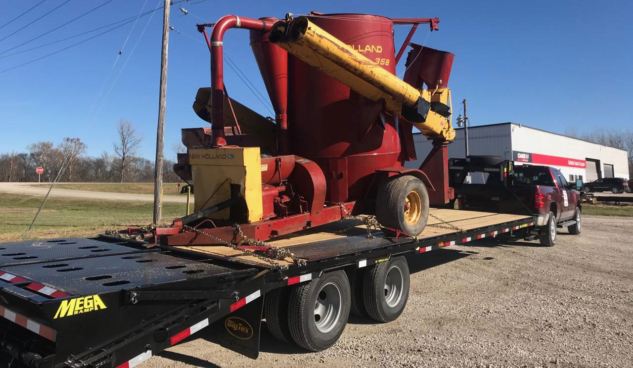 Transporting New Holland 358 Grinder Mixer