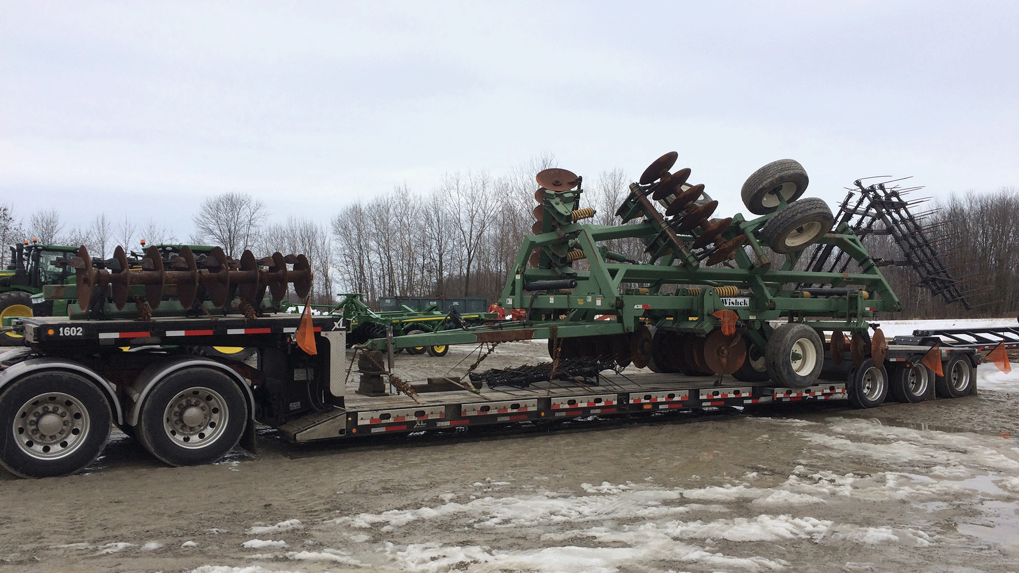 Hauling Wishek 862NT Tandem Disc Harrows