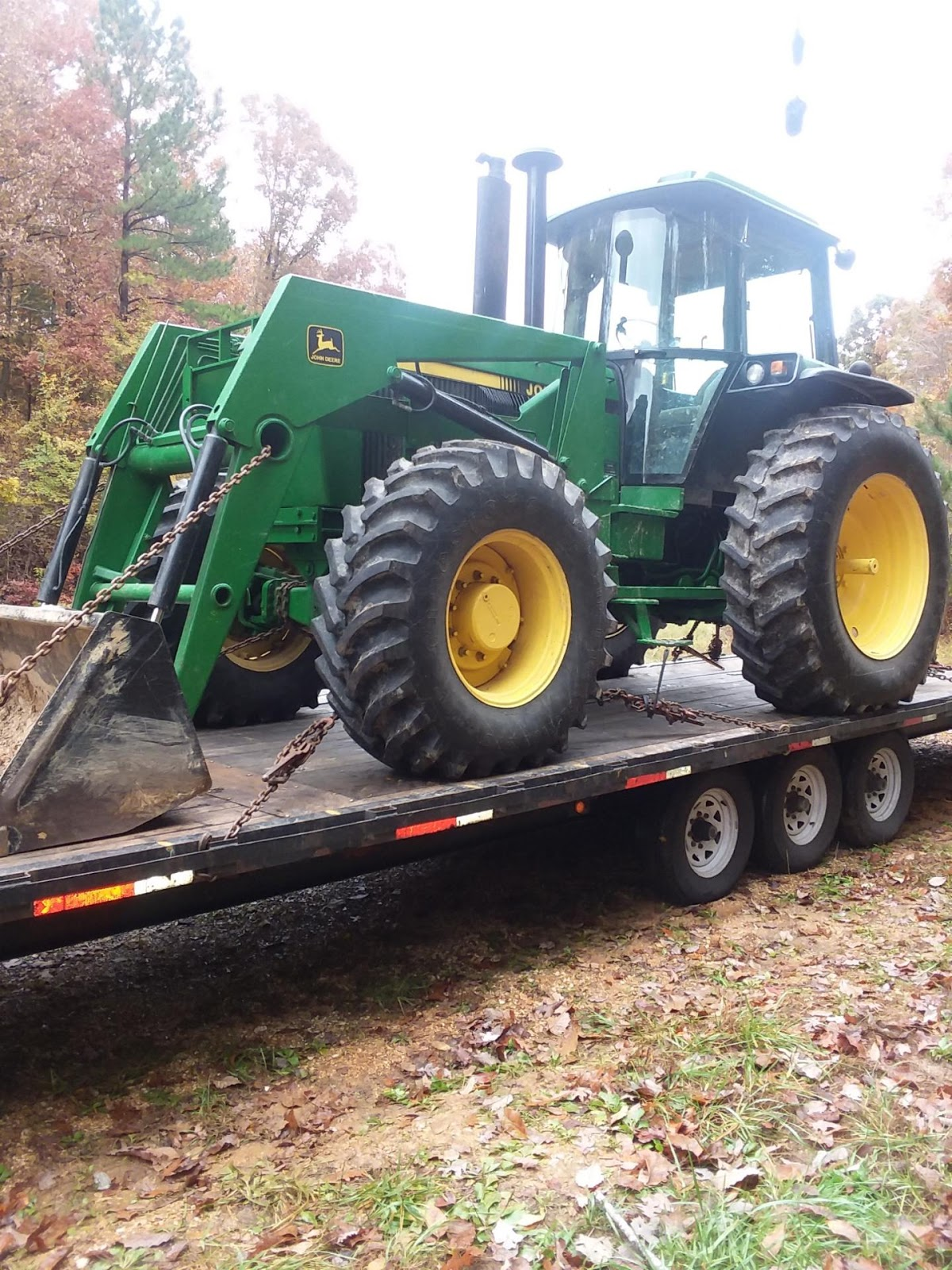 1995 John Deere 4050 tractor being hauled