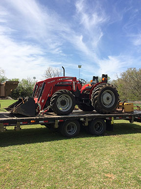 2010 Massey Ferguson DL250 being transported