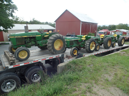 4 John Deere 2640 Tractors being transported