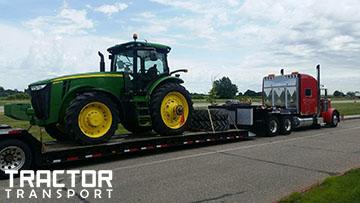 Hauling John Deere 8360R tractor