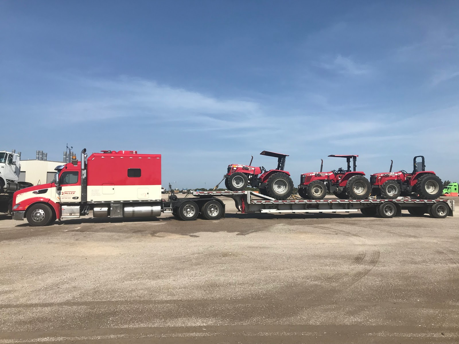 3 massey ferguson 2660 tractors being transported